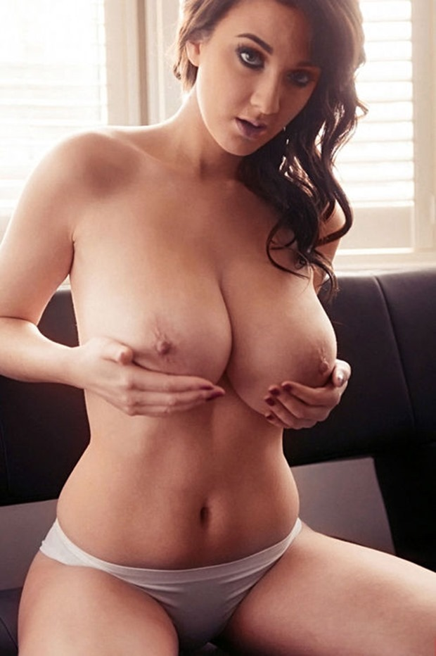 huge juggs babe cradling her boobs in her hands with white panties on